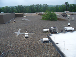 A commercial rooftop before silicone roof coating is applied