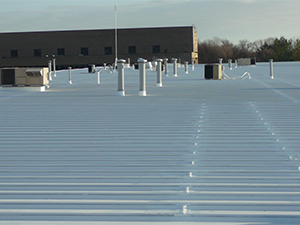 Commercial metal roof with a protective coating applied