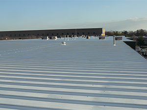 A commercial rooftop with a coating