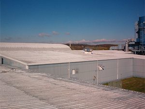 Commercial rooftops before a cool roofing job took place