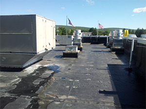 Roof in need of repair with leaks at a commercial facility