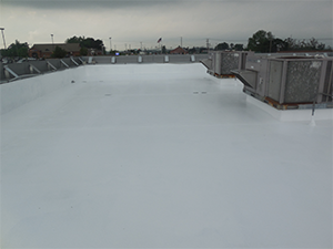 White roof coating on a commercial roof