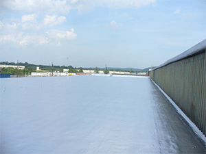 A commercial rooftop with a roof coating