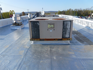 A commercial flat roof with a protective coating
