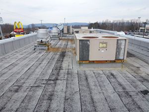 Roof restoration in process at a commercial facility