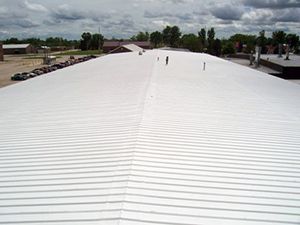 White coating on a commercial metal roof