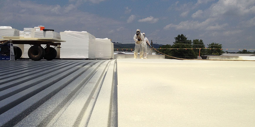Fluid applied membrane being used to coat a commercial facility's metal roof
