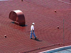 an worker giving a roof an inspection