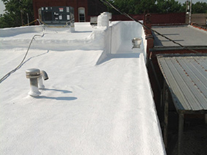 White coating applied on a commercial roof