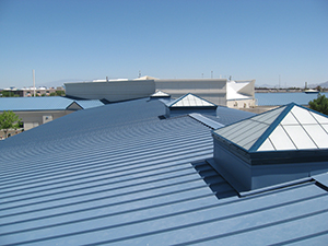 Blue commercial roof applied with a coating material for protection