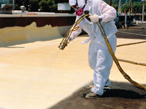 Paint being applied on a commercial roof