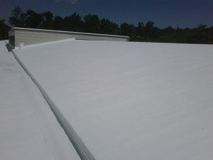 A white coated commercial roof