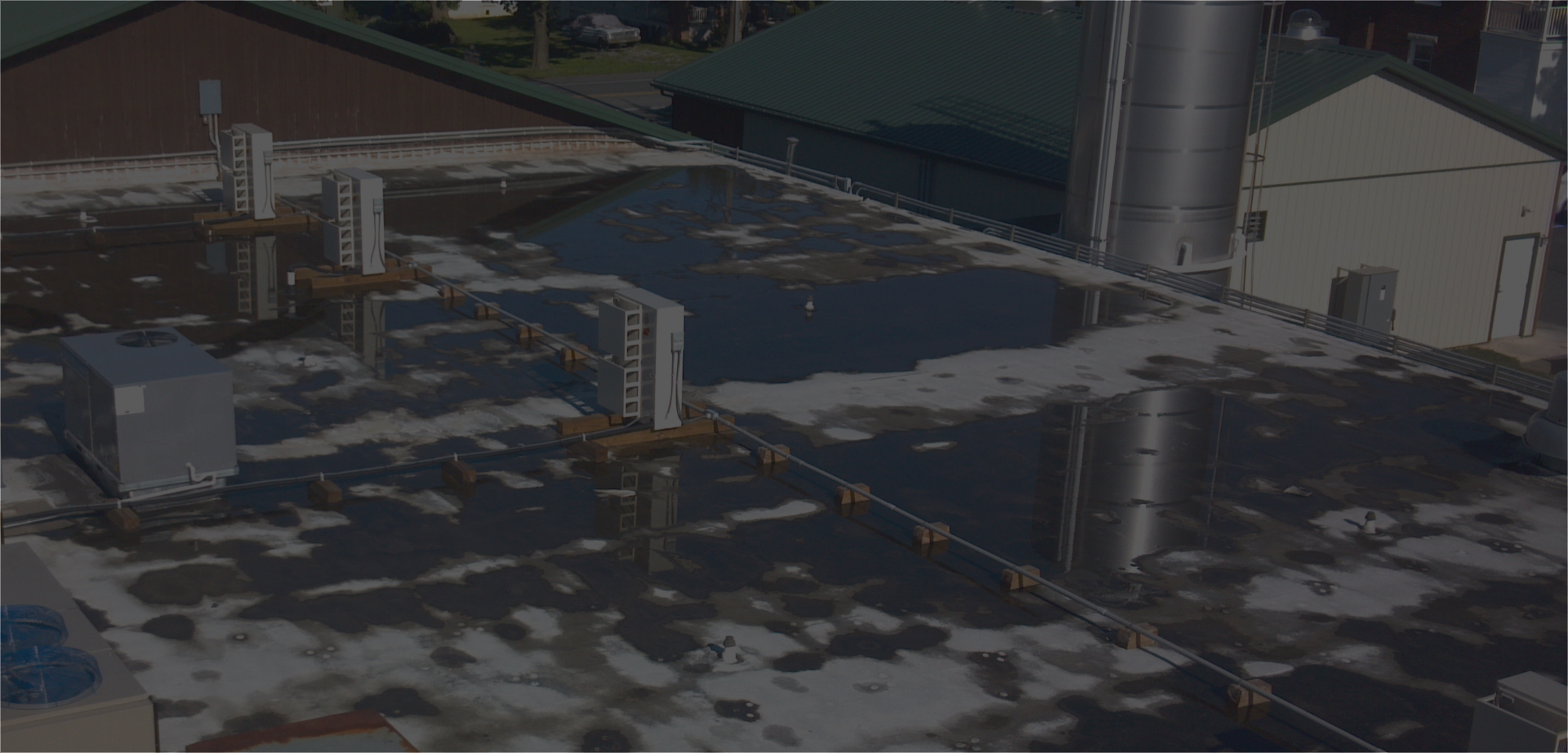 Warehouse Roof with Water Puddles